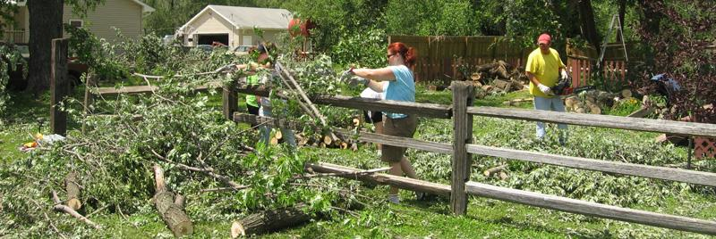 day laborers - unaffiliated volunteers removing storm damage